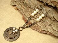 Vintaj brass leaf sparrow necklace