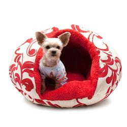 pink and white spring flowers adorn a cave like small dog bed