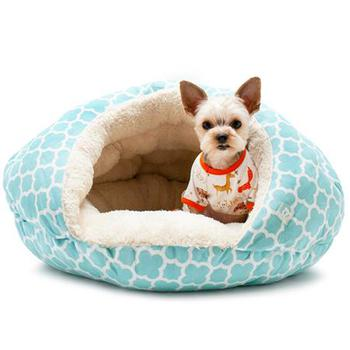 small round cave like dog bed with blue flowers